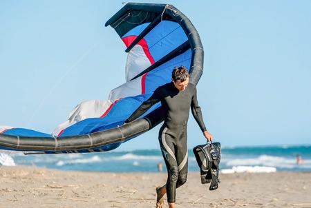 kiter: Ulcinj, Montenegro- July 18, 2016: Kitesurfer with  Kitesurf power kite on the beach in Ulcinj, Montenegro