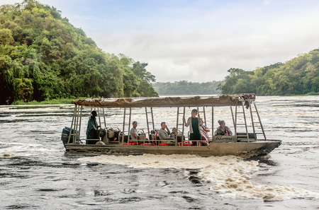 white nile: Uganda,Africa- April 1, 2016:Tourist visit the Murchison Falls on the White Nile river, Uganda Editorial