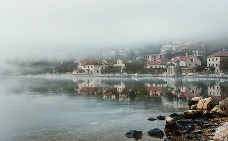 boka: Village at Boka Kotor Bay in the morning fog, Montenegro