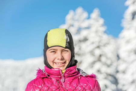 snowcovered: Portrait of a beautiful little girl wearing ski mask