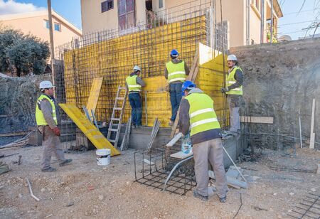 hard component: Tivat, Montemegro- December 7, 2016: Team of workers working on a new building construction site Editorial