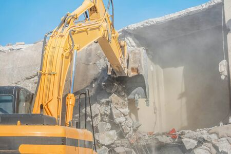 Demolition of an old house with excavator