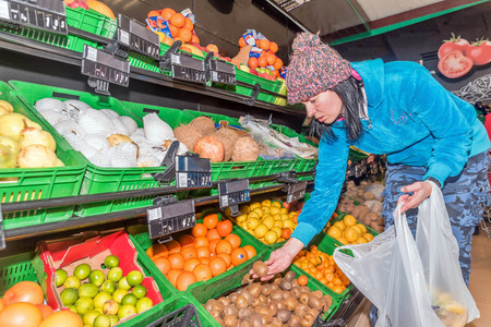 Young woman shopping for fruits in a supermarket Stock Photo
