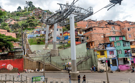 Cable cars travel over Medellin slums, Colombia Editorial