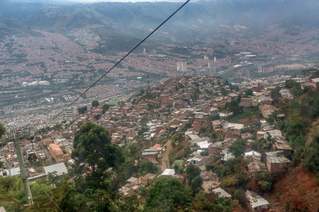 Cable cars travel over Medellin slums, Colombia Stock Photo