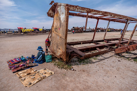 bolivian: Woman selling souvenirs at train cemetery in Bolivia Editorial