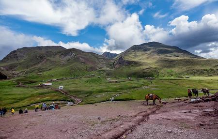 People hiking on Vinicunca aka Rainbow Mountain in the region of Cusco, Peru