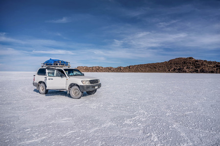unruffled: Off- road car on lake Salar de Uyuni, Bolivia