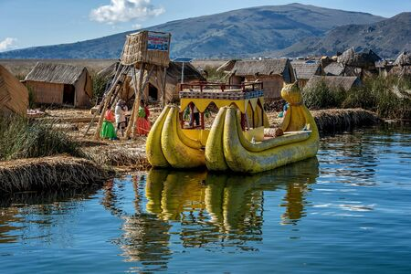 island: Weathered reed boats along the coast of Lake Titicaca in Puno, Peru