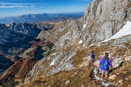Two little girls hiking on the Mountains in National Park Durmitor, Montenegro Stock Photo
