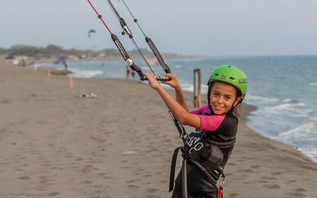 Little girl learning to kitesurf Stock Photo