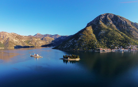 Our Lady of the rocks church and the Island of Saint George  in the Bay of Kotor, Montenegro Stock Photo