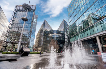 London, UK- January 10, 2018:Fontain near City Hall and modern glass buildings in London, UK