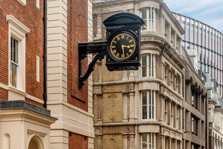 Clock on a facade of a building of London, England