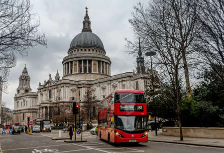 London, UK- January 12, 2018: Red bus in front of Saint Pauls Cathedral in London, UK