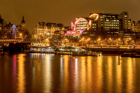 The Charing Cross station and Hungerford Bridge by the River Thames, London