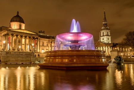 London, UK- January 12, 2018: The Fountain in Trafalgar Square at night in London, UK Stock Photo