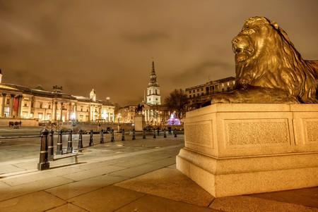 London, UK- January 12, 2018: Lion Statue at Trafalgar Square at night  in London, UK