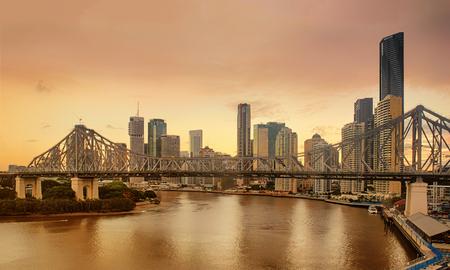 View of Brisbane bridge on the river at sundown, Australia