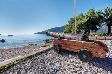 Canon by the Statue of king Stephen Tvrtko I in port of  Herceg Novi, Montenegro Foto de archivo