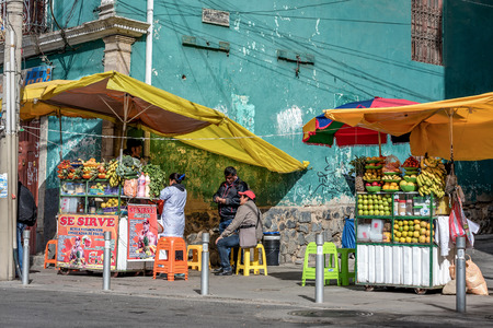 La Paz, Bolivia- March 28, 2017: People selling fresh fruit on the street in  La Paz, Bolivia