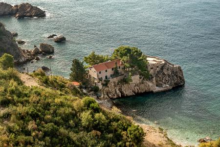 Stone house on the islet near Budva, Montenegro