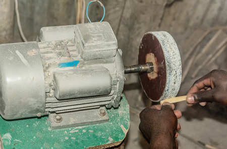 Manually improvisation of metal turnery for wood carving in Kenya Stock Photo
