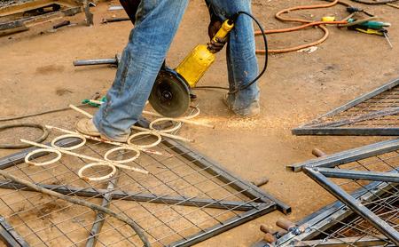 Male worker cutting steel fence in Nairobi, Kenya