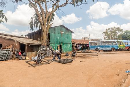 Nairobi, Kenya- March 5, 2016:Male workers welding steel with lighting  in Kibera slum, Nairobi