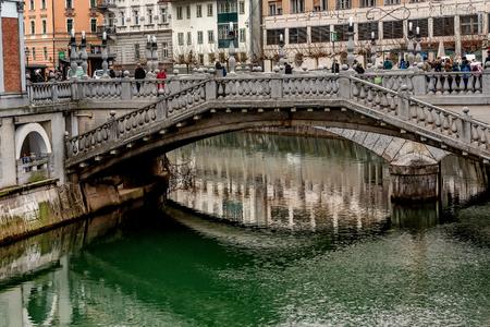 Ljubljana, Slovenia- January 7, 2019: The triple bridge on the river Ljubljanica in Ljubljana, Slovenia