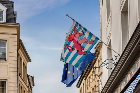 Luxembourg, Luxembourg- January 10, 2019:Luxembourg flag and European Union flag hanging on the building in Strasbourg, France