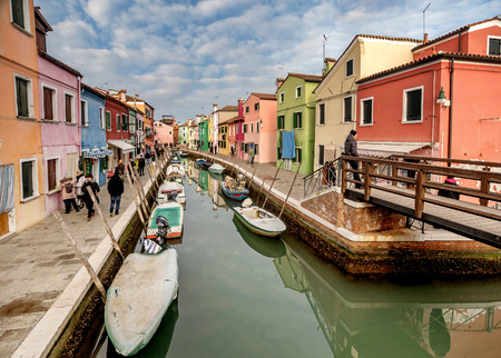 Venice, Italy- January 19, 2019:Typical view of  colorful houses on Burano island near Venice, Italy