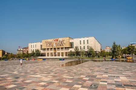 Tirana, Albania- August 10, 2019:National Historical Museum and Skanderbeg Square in Tirana, Albania