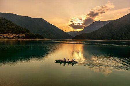 Pluzine, Montenegro- July 22, 2019: Beautiful view of Piva lake at sundown, Montenegro Publikacyjne