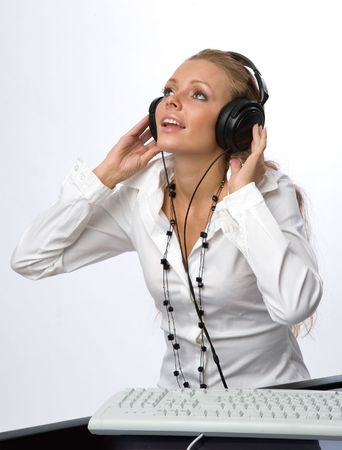 A girl listens to music with pleasure
