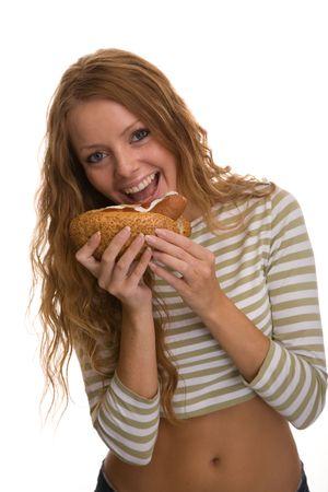 girl eating hot dog
