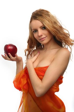 girl holding in her hand a red apple