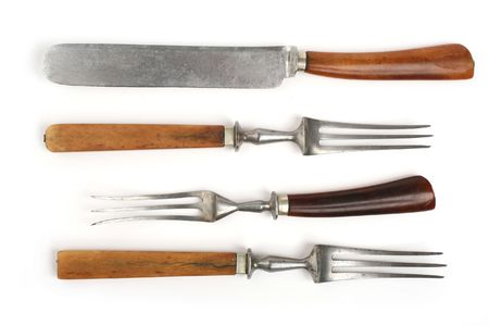 antique cutlery, fork and knife on white background Stock Photo