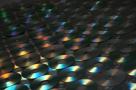 many dvd, cd with beautiful color highlights(in the dark tonality Stock Photo