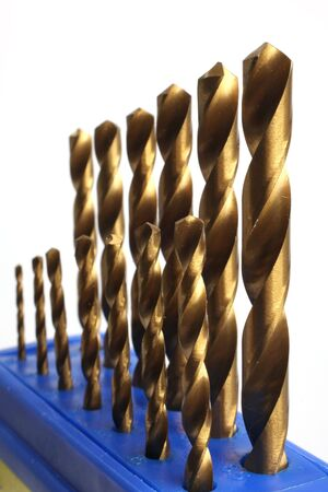 a set of drill bits of golden color