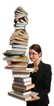 girl holding a very large pile of books Stock Photo