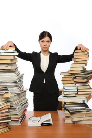 girl and two large piles of books Stock Photo