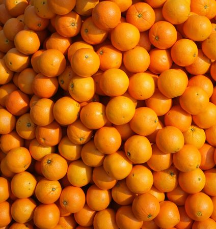 a lot of juicy, ripe oranges closeup Stock Photo
