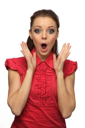 pretty girl in a red blouse very surprised (white background) Stock Photo