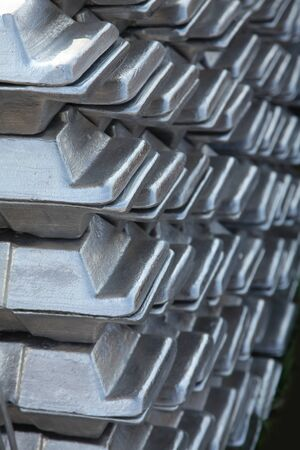 castings: a stack of aluminum casting in stock for background use Stock Photo