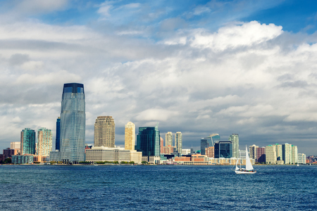 Jersey city skyline and a sailing yacht view from ferry