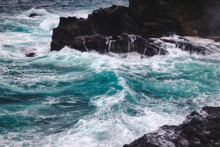 Stromy weather with big waves at rocky coastline of Oahu island, Hawaii