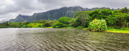 Panoramic view of lake and mountains in Hoomaluhia botanical garden, Oahu island, Hawaii
