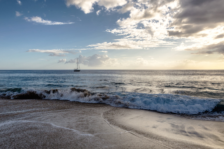 Evening view of sailboat from the beach of Oahu island, Hawaii