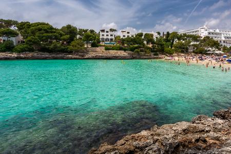 Crowded beach Cala Gran in Cala d'Or, Mallorca during summer season